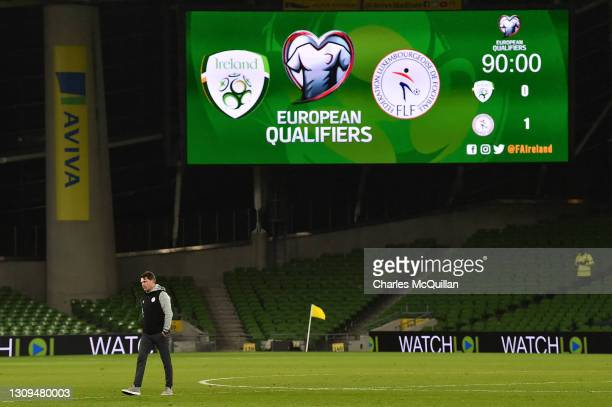 Luc Holtz, Head Coach of Luxembourg walks on the picth as the big screen displays the score after the FIFA World Cup 2022 Qatar qualifying match...