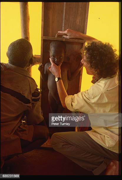Luc Legrand a French nurse measures a young Mozambican boy in a refugee camp Hundreds of thousands of Mozambicans have fled Mozambique on foot to...