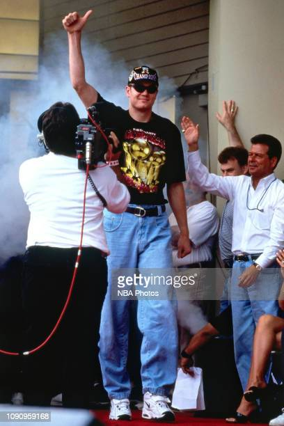Luc Longley of the Chicago Bulls celebrates at the Chicago Bulls Championship Parade and Rally on June 16 1997 at Grant Park in Chicago Illinois NOTE...