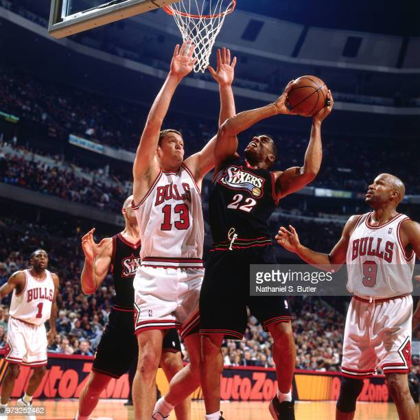 Luc Longley of the Chicago Bulls defends Jim Jackson of the Philadelphia 76ers during a game played on November 1 1997 at the First Union Arena in...