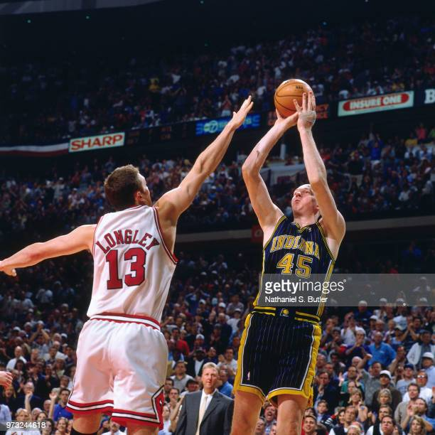 Luc Longley of the Chicago Bulls defends Rik Smits of the Indiana Pacers during a game played on May 31 1998 at the United Center in Chicago Illinois...