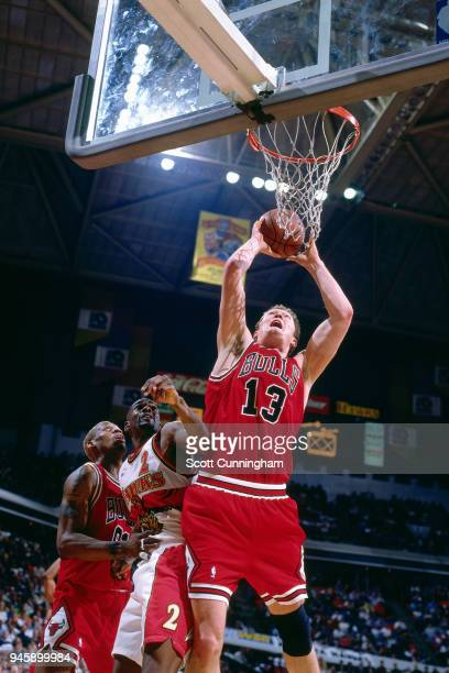 Luc Longley of the Chicago Bulls goes to the basket against the Atlanta Hawks on February 22 1996 at the Omni Coliseum in Atlanta Georgia NOTE TO...