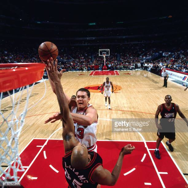 Luc Longley of the Chicago Bulls shoots against the Philadelphia 76ers during a game played on November 1 1997 at the First Union Arena in...