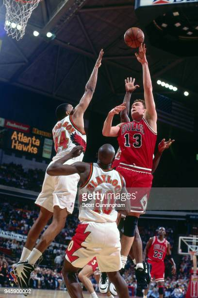 Luc Longley of the Chicago Bulls shoots the ball against the Atlanta Hawks on February 22 1996 at the Omni Coliseum in Atlanta Georgia NOTE TO USER...