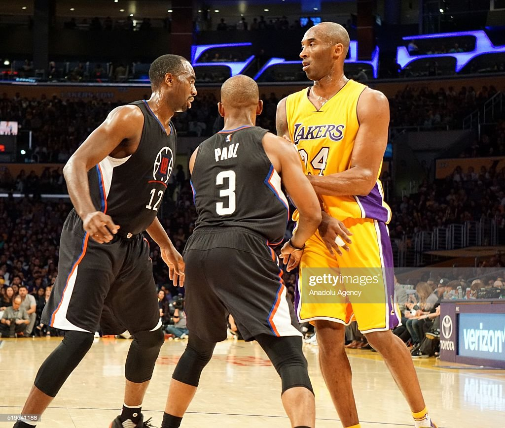 Luc Mbah a Moute (L) and Chris Paul (C) of Los Angeles Clippers in action against Kobe Bryant (R) of Los Angeles Lakers during the NBA match between Los Angeles Clippers and Los Angeles Lakers at Staples Center, in Los Angeles, USA on April 6, 2016.