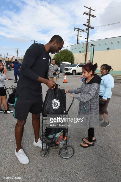 Luc Mbah a Moute of the LA Clippers distributes food and personal care items on October 13 2018 at the Salvation Army Siemon Family Youth Community...