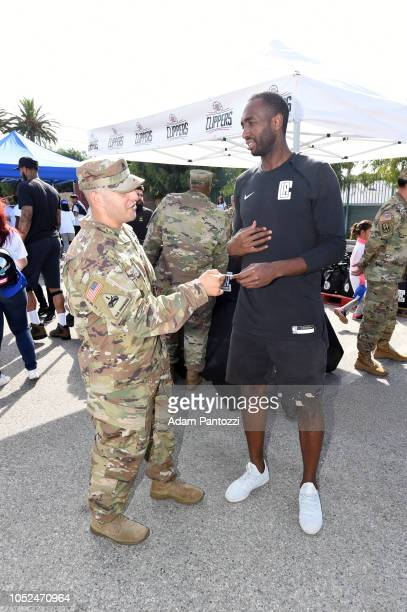 Luc Mbah a Moute of the LA Clippers speaks to military personnel on October 13 2018 at the Salvation Army Siemon Family Youth Community Center in Los...
