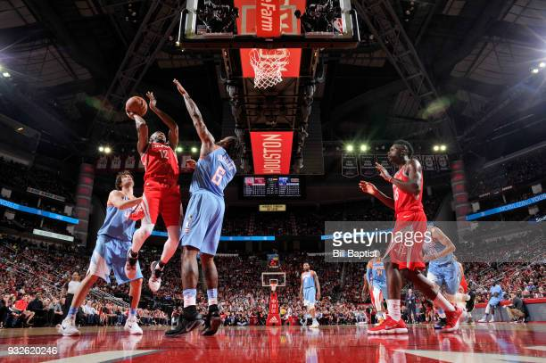 Luc Mbah a Moute of the Houston Rockets goes to the basket against the LA Clippers on March 15 2018 at the Toyota Center in Houston Texas NOTE TO...