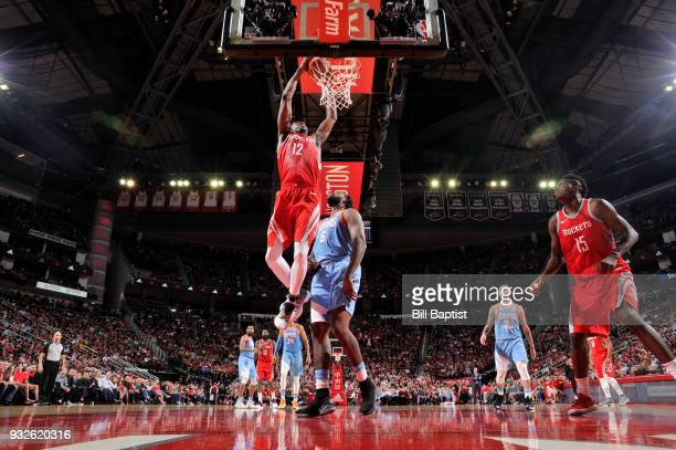 Luc Mbah a Moute of the Houston Rockets goes up for a dunk against the LA Clippers on March 15 2018 at the Toyota Center in Houston Texas NOTE TO...