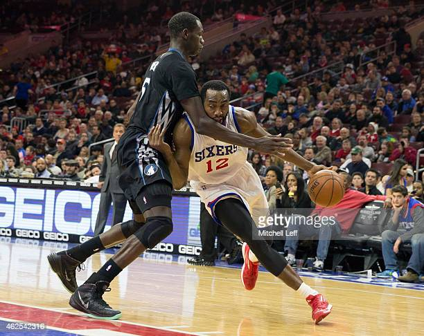Luc Mbah a Moute of the Philadelphia 76ers drives to the basket with Gorgui Dieng of the Minnesota Timberwolves defending on the play on January 30...