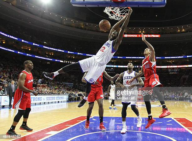 Luc Mbah a Moute of the Philadelphia 76ers dunks over Matt Barnes of the Los Angeles Clippers on March 27 2015 at the Wells Fargo Center in...