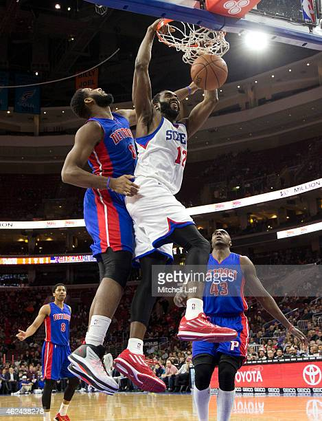 Luc Mbah a Moute of the Philadelphia 76ers dunks the ball with Andre Drummond of the Detroit Pistons defending on the play on January 28 2015 at the...