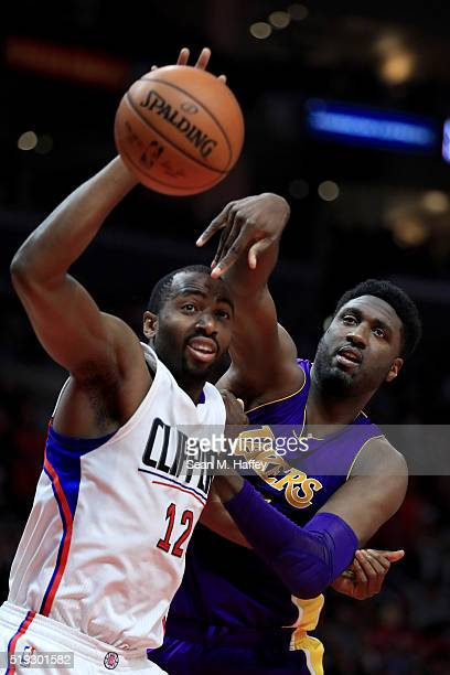 Luc Richard Mbah a Moute of the Los Angeles Clippers and Roy Hibbert of the Los Angeles Lakers battle for a rebound during the second half of an NBA...