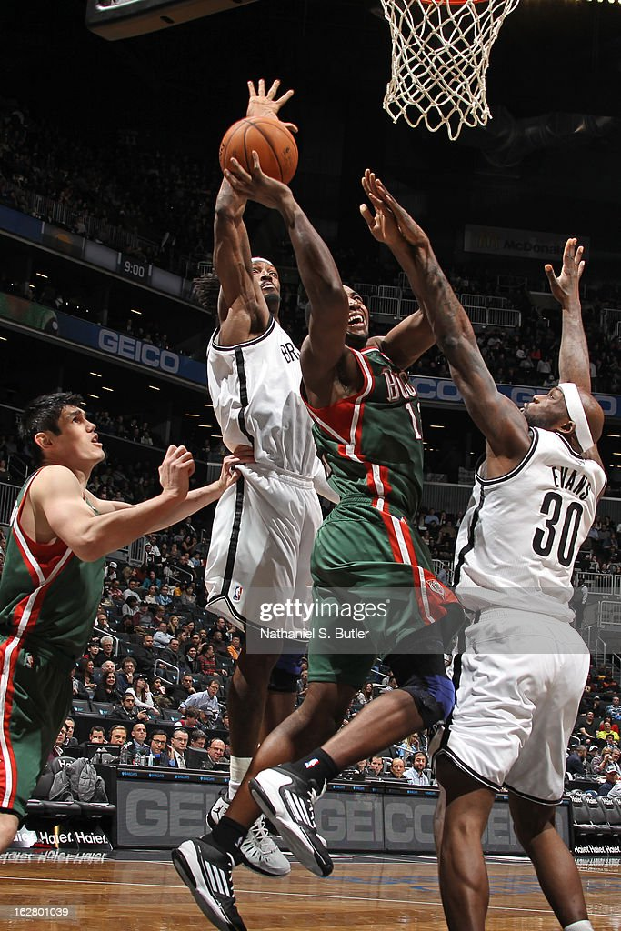 Luc Richard Mbah a Moute #12 of the Milwaukee Bucks gets his shot blocked by Gerald Wallace #45 of the Brooklyn Nets on February 19, 2013 at the Barclays Center in the Brooklyn borough of New York City.