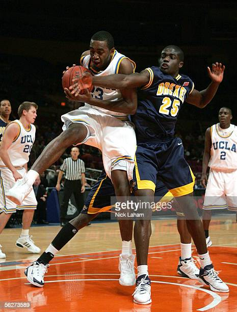 Luc Richard Mbah a Moute of the UCLA Bruins fights for a rebound with Randy Oveneke of the Drexel Dragons during their Preseason NIT Tournament game...