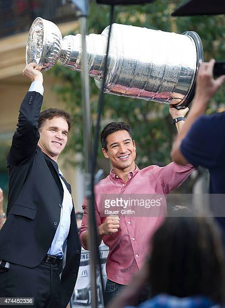 Luc Robitaille and Mario Lopez are seen posing together with the Stanley Cup at 'Extra' at The Grove on October 11 2012 in Los Angeles California