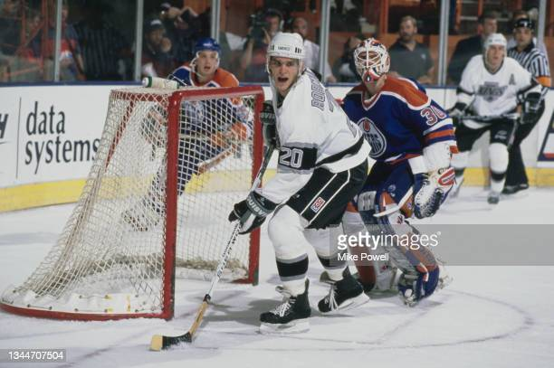 Luc Robitaille from Canada and Left Wing for the Los Angeles Kings and compatriot Bill Ranford, Goaltender for the Edmonton Oilers in motion on the...