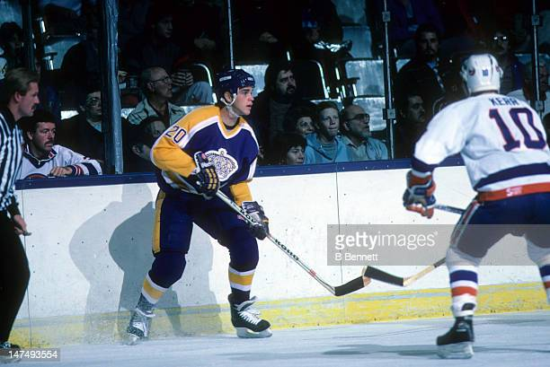 Luc Robitaille of the Los Angeles Kings looks for a pass during an NHL game against the New York Islanders on October 25 1986 at the Nassau Coliseum...