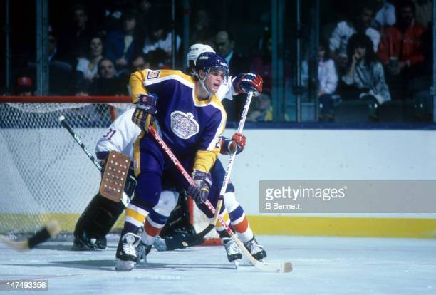 Luc Robitaille of the Los Angeles Kings looks to deflect the shot during an NHL game against the New York Islanders on October 25 1986 at the Nassau...