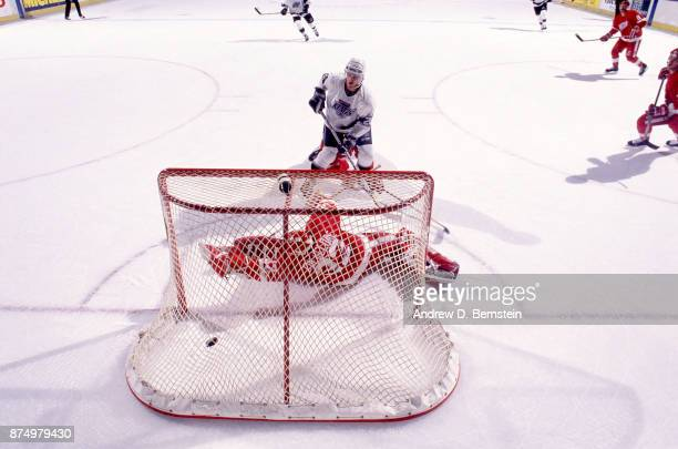 Luc Robitaille of the Los Angeles Kings scores goal against the Detroit Redwings on October 9 1989 at the Great Western Forum in Inglewood California
