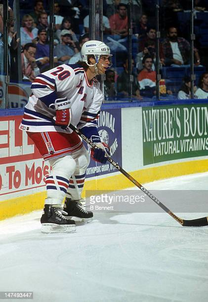 Luc Robitaille of the New York Rangers holds the puck behind the net during an NHL game against the New York Islanders on October 17 1995 at the...