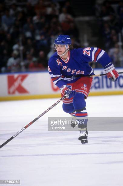 Luc Robitaille of the New York Rangers skates on the ice during an NHL game against the New York Islanders in 1996 at the Nassau Coliseum in...