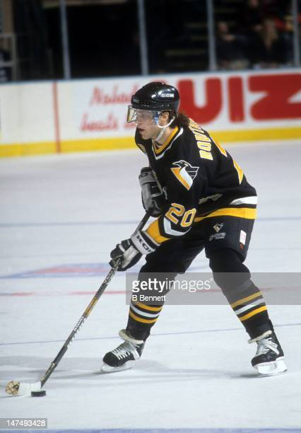Luc Robitaille of the Pittsburgh Penguins skates with the puck during an NHL game against the New York Rangers on January 25 1995 at the Madison...