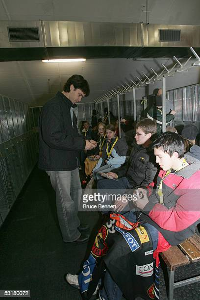 Luc Robitaille of the Primus Worldstars signs autographs before the game against SC Bern on December 15, 2004 at Bern Arena in Bern, Switzerland. The...