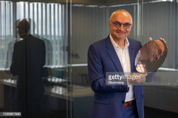 Luc Van den hove, president of the Interuniversity Microelectronics Centre , with a 300 millimetre wafer used for semiconductor research, in his...