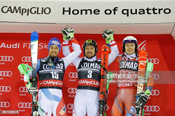 Luca Aerni of Switzerland takes 2nd place Marcel Hirscher of Austria takes 1st place Henrik Kristoffersen of Norway takes 3rd place during the Audi...