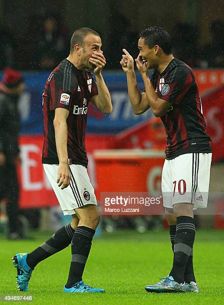 Luca Antonelli of AC Milan celebrates with his teammate Carlos Bacca after scoring the opening goal during the Serie A match between AC Milan and AC...