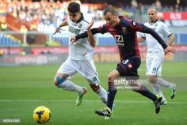 Luca Antonelli of Genoa CFC competes with Luca Antei of US Sassuolo Calcio during the Serie A match between Genoa CFC and US Sassuolo Calcio at...