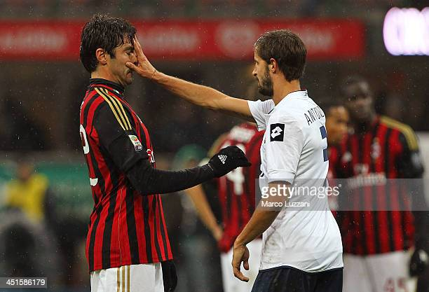 Luca Antonini of Genoa CFC reacts with Ricardo Kaka of AC Milan during the Serie A match between AC Milan and Genoa CFC at Stadio Giuseppe Meazza on...