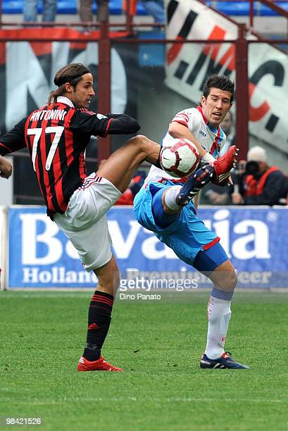 Luca Antonini of Milan battles for the ball with Mariano Izco of Catania during the Serie A match between AC Milan and Catania Calcio at Stadio...