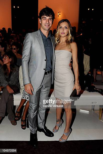 Luca Argentero and Myriam Catania attend the Gucci Spring/Summer 2011 fashion show during Milan Fashion Week on September 22 2010 in Milan Italy