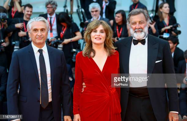 Luca Barbareschi Emmanuelle Seigner and Alain Goldman walk the red carpet ahead of the closing ceremony of the 76th Venice Film Festival at Sala...
