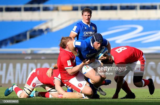 Luca Bigi of Italy is tackled by Tomas Francis and Taulupe Faletau of Wales during the Guinness Six Nations match between Italy and Wales at Stadio...
