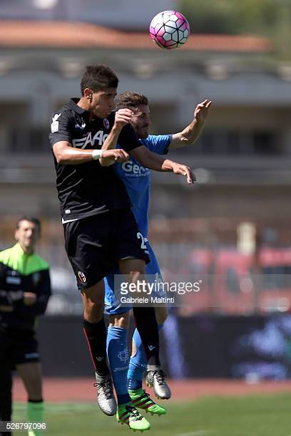Luca Bittante of Empoli FC battles for the ball with Adam Masina of Bologna Fc during the Serie A match between Empoli FC and Bologna FC at Stadio...