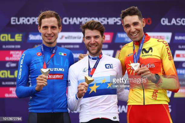 Luca Braidot of Italy Lars Forster of Switzerland and David Valero Serrano of Spain pose for a photo at the podium after the Men's Mountain Bike...