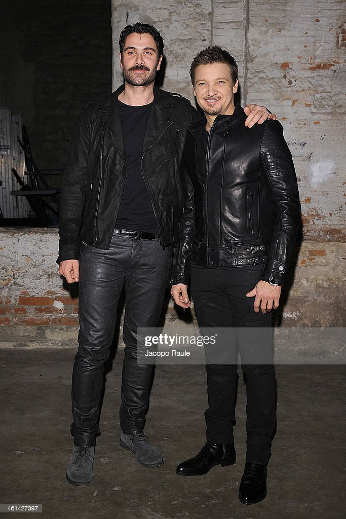 Luca Calvani and actor Jeremy Renner attend Diesel Black Gold fashion show during Pitti Immagine Uomo 85 on January 8, 2014 in Florence, Italy.
