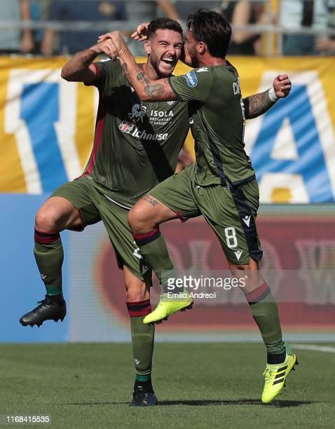 Luca Ceppitelli of Cagliari Calcio celebrates his second goal with his team-mate Luca Cigarini during the Serie A match between Parma Calcio and...