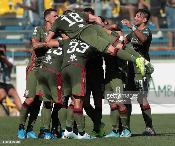 Luca Ceppitelli of Cagliari Calcio celebrates his second goal with his teammates during the Serie A match between Parma Calcio and Cagliari Calcio at...
