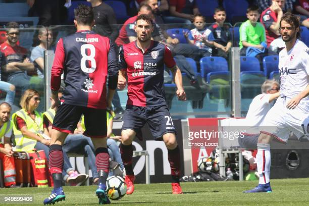 Luca Cigarini and Artur Ionita of Cagliari in action during the serie A match between Cagliari Calcio and Bologna FC at Stadio Sant'Elia on April 22...