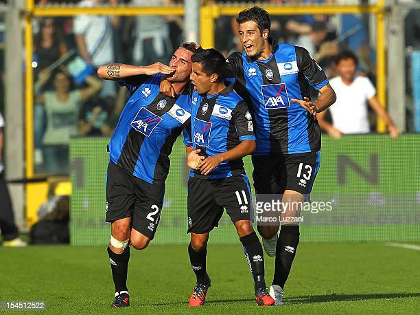 Luca Cigarini of Atalanta BC celebrates with his teammates Maximiliano Moralez and Federico Peluso after scoring his goal during the Serie A match...