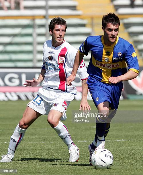 Luca Cigarini of Parma of beats Mariano Izco of Catania during the Seria A league match between Parma and Catania at the Stadio Ennio Tardini on...