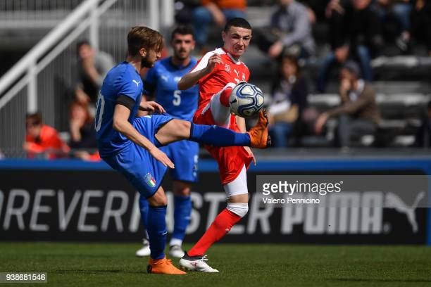 Luca Clemenza of Italy U20 competes with Ruben Vargas of Switzerland U20 during the 8 Nations Tournament match between Italy U20 and Switzerland U20...