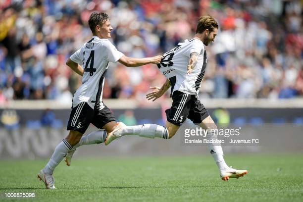 Luca Clemenza of Juventus celebrates with Nicolò Fagioli after scoring the equalizer during the International Champions Cup 2018 match between...