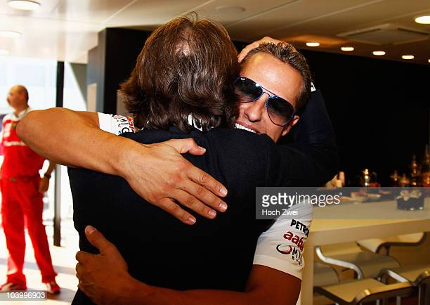 Luca Cordero di Montezemolo Chairman of Ferrari embraces Michael Schumacher of Germany and Mercedes GP following qualifying for the Italian Formula...