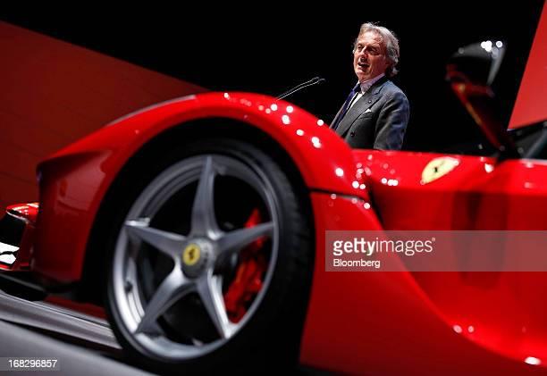 Luca Cordero Di Montezemolo chairman of Ferrari SpA speaks near a Ferrari LaFerrari automobile during a news conference at the company's plant in...