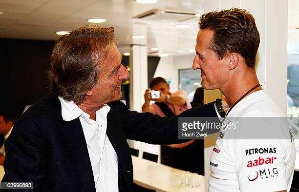 Luca Cordero di Montezemolo Chairman of Ferrari talks with Michael Schumacher of Germany and Mercedes GP following qualifying for the Italian Formula...